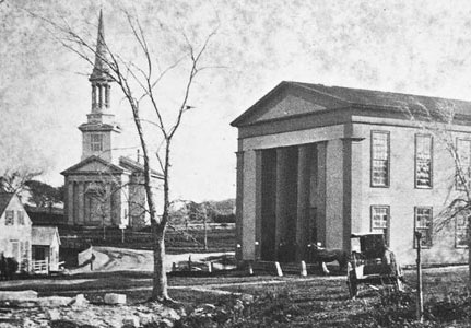 Town Hall in the late 1870s from a stereoscope card taken by Minnie Cook. Note that here Town Hall is painted in two colors. In the 1900s it was all white.